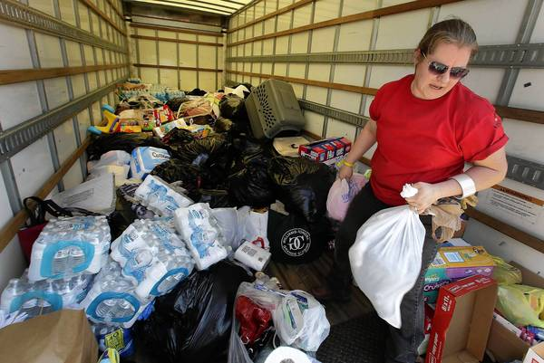 Jeanette Shell of Lacy Lakeview, Texas, unloads goods Monday for victims of last week's fertilizer plant explosion in West, Texas. Finger-pointing over the accident has been minimal, a reflection of the state's long-standing tradition of limited regulation.