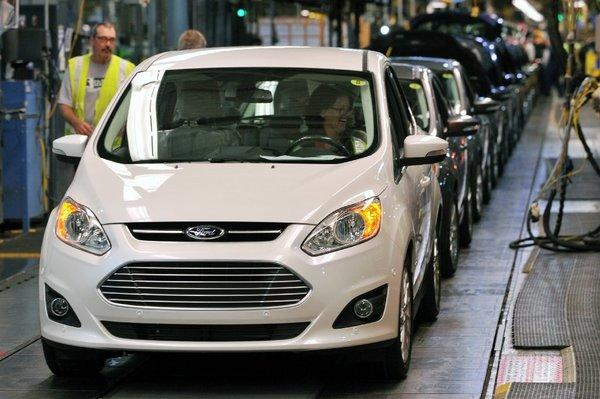 A C-MAX hybrid rolls off the line at a Ford plant in Michigan. The Interior Department will begin adding hybrid vehicles to its fleet.