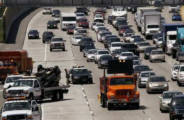 Traffic backs up on the southbound lanes of the 405 Freeway in Costa Mesa as a crash is cleaned up on Tuesday afternoon.