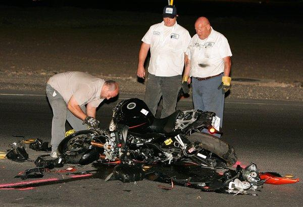 Officials inspect the scene of a fatal motorcycle crash in Las Vegas. According to a new study, motorcycle fatalities in the U.S. rose 9% last year.