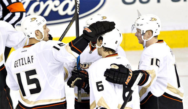 Ryan Getzlaf, Ben Lovejoy and Corey Perry celebrate a goal on the Oilers during the third period of the Ducks' 3-1 victory over Edmonton on Sunday.