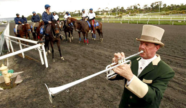 Jay Cohen blows on the Herald trumpet to call the horses to the track for his 25th year on April 26, 2012 at the opening day at Betfair Hollywood Park.