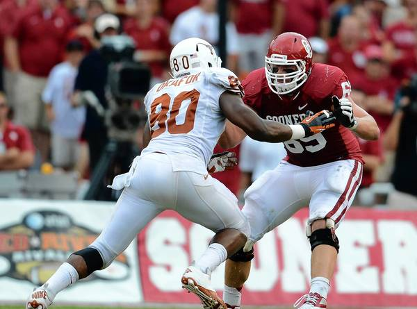 Oklahoma Sooner tackle Lane Johnson (69) in action against Texas Longhorns defensive end Alex Okafor (80) during the red river rivalry at the Cotton Bowl. Eagles beat writer Nick Fierro predicts the Eagles will land Johnson in the first round.