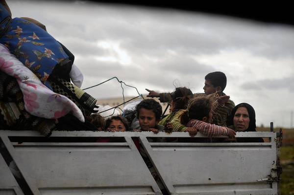 A Syrian family leaves Aleppo by truck this month. Israel's top military intelligence analyst says the Assad regime used chemical weapons in attacks last month near that northern city and near the capital, Damascus.