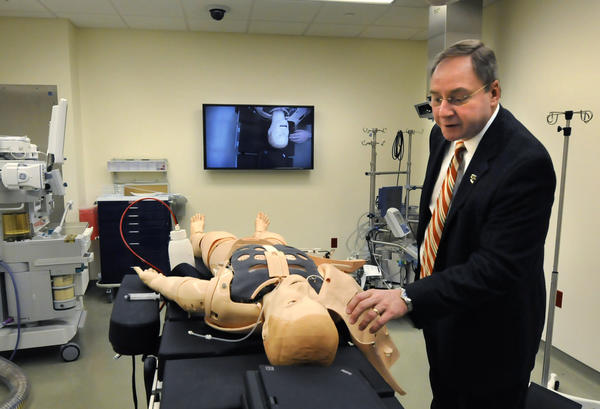 Dr. Bruce M. Koeppen, dean of Quinnipiac University's Frank H. Netter School of Medicine in North Haven examines Sim Man, an electronic man or woman that can simulate various medical emergencies in any setting. The medical school will be open for the first 60 medical students soon.