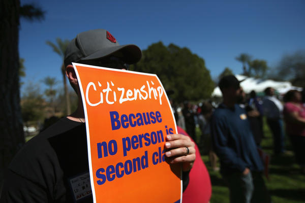 Union backers gather in support of national immigration reform at the Arizona state Capitol in Phoenix in March.