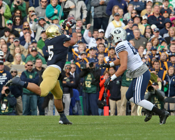 Notre Dame linebacker Manti Te'o (5) intercepts a pass against BYU last season.