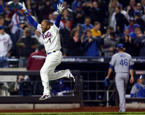 Mets center fielder Jordany Valdespin celebrates as he leaps toward home plate after hitting a game-winning grand slam off Dodgers reliever Josh Wall (46) in the 10th inning Wednesday night in New York.