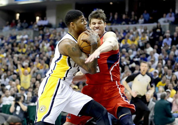 The Pacers' Paul George, left, drives to against the Hawks' Kyle Korver during Game 2 on Wednesday.