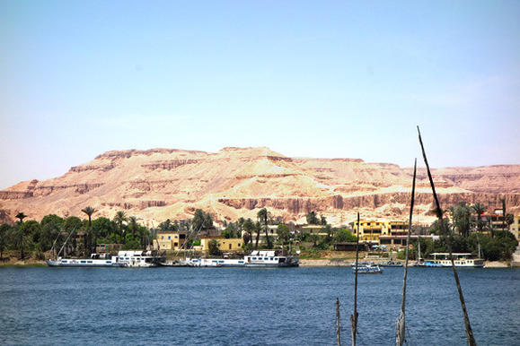 From the town of Luxor, cafes offer stunning views of the river and the tomb-filled folds of the desert hillsides beyond.