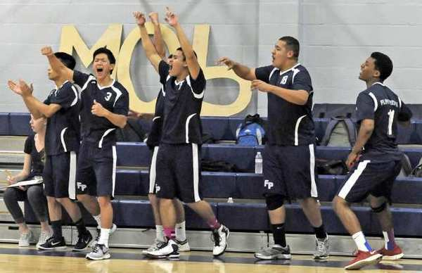The Flintridge Prep boys' volleyball bench reacts during the fourth game of a Prep League volleyball match against Chadwick on Wednesday. The Rebels clinched a league championship after a 25-15, 23-25, 25-18, 24-26, 15-13 victory. (Photo by Libby Cline)