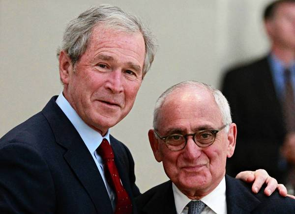 George W. Bush poses for a photo with Robert Stern, architect of the former president's library, which is to be dedicated Thursday on the campus of Southern Methodist University.