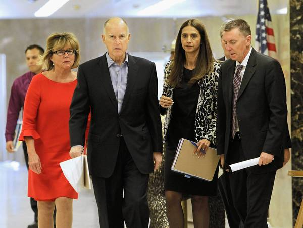 Gov. Jerry Brown walks to a news conference on proposed education spending reforms with Mary Jane Burke, from the Marin County Office of Education, left; Thelma Melendez de Santa Ana, of the Santa Ana Unified School District, second from right; and LAUSD's John Deasy, right.