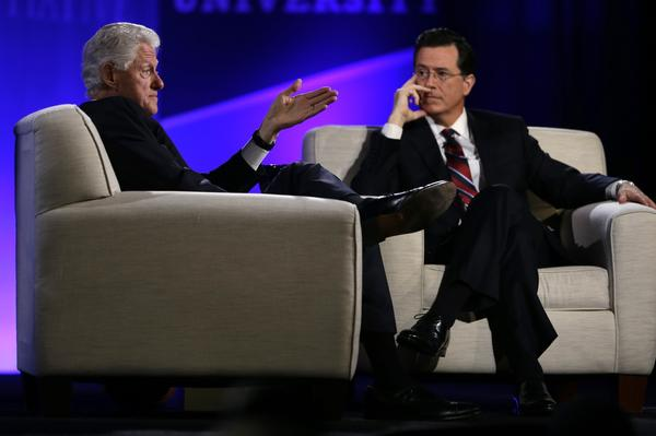 Former President Bill Clinton and Comedy Central's Stephen Colbert speak during the Clinton Global Initiative at Washington University. Colbert convinced Clinton to open a Twitter account.