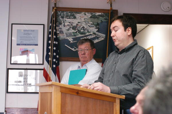 Charlevoix County equalization director Patrick Suboski (left) and assistant director Jeff Grimm presented the 2013 county equalization report to the board of commissioners Wednesday.