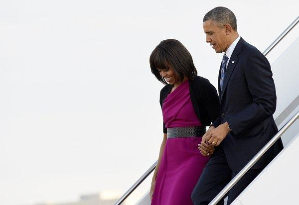 President Obama and First Lady Michelle Obama arrive at Love Field in Dallas on Wednesday.