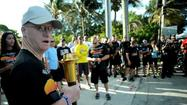 Special Olympian Larnin Killen of Margate prepares to run the openining leg of the the Broward Law Enforcement Torch Run, Thursday, April 25, 2013.  About 300 law enforcement officers from were participating in the run from the Broward/Miami Dade County line to the Broward/Palm Beach County line.