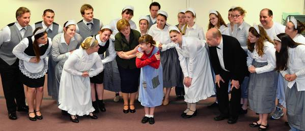 The Village of Orland Park Theatre Troupe will perform the musical Annie on April 26, 27 and 28 at the Performing Arts Center of Carl Sandburg High School. The cast is shown here as the servants at Oliver Warbucks' mansion, ready to deliver whatever Annie (Sarah Walton of New Lenox) wants.