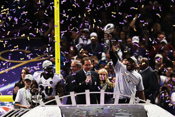 Ray Lewis #52 of the Baltimore Ravens celebrates with the Vince Lombardi trophy after the Ravens won 34-31 against the San Francisco 49ers during Super Bowl XLVII at the Mercedes-Benz Superdome on February 3, 2013 in New Orleans, Louisiana.