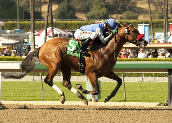 Kevin Krigger and Goldencents race to victory at the Santa Anita Derby on April 6.