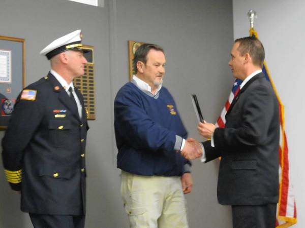 Orland Fire Protection District Trustee Marty McGill, center, is honored for his service by Board President Jim Hickey, right, and Fire Chief Ken Brucki, left, at an April 23 board meeting.