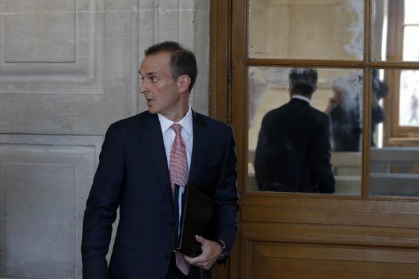 The head of the U.S. Anti-Doping Agency, Travis Tygart, arrives for a senate-led inquiry into the fight against doping in Paris.