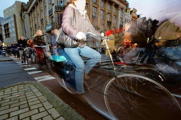 Commuters ride their bikes in late afternoon traffic near Amsterdam Central Station on Nov. 2, 2012.