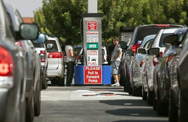 Costco members fill up in Van Nuys on a day last October when gasoline prices hit a record high for the state. Ford is now offering $25,000 for the best phone app for fuel efficiency.