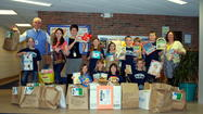 Students from Sheridan and Central elementary schools in Petoskey collaborated with Leadership Little Traverse class of 2013 to host book drives for the leadership service project, FreeCycle Book Bins. With the help of these two Petoskey elementary schools, more than 2,000 books were collected during the week-long schoolwide book drives.