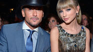 "<span style=""font-size: small;"">People magazine's latest issue reveals their picks for the Most Beautiful Celebrities in 2013, and a few of country music's biggest stars made the cut. Taylor Swift, Carrie Underwood and Tim McGraw were each recognized for their stunning good looks, but like everyone else, they admit they haven't always felt secure with their own appearance. ""I'm pretty pale,"" Taylor confesses to People (quote via Lancaster, Pa. radio station WIOV). ""In high school, I was insecure and thought it'd be cool to go to a tanning bed. Now, I just let it look the way it looks."" Carrie admits that even though she has graced magazine covers and often appears on best-dressed lists, it took finding her soul mate to accept her true beauty. ""I've spent a fair share of money on creams and makeup to help minimize my scars,"" the songstress reveals. ""Then I met [husband] Mike Fisher. He made me feel loved and beautiful ... scars and all."" Tim, the husband of beautiful Faith Hill, credits keeping up a rigorous workout regime and abstaining from alcohol with helping him look his best, and still downplays his rugged good looks. ""Thank God for country music,"" he jokes. ""That's my reaction, because I sure wouldn't be picked standing on the street corner. It's a good thing I've got a guitar in my hand up under the lights."" Reba McEntire, who at age 58 still turns heads, is also named in a special Beautiful at Every Age feature. People's Most Beautiful issue will be on newsstands April 26. </span>"