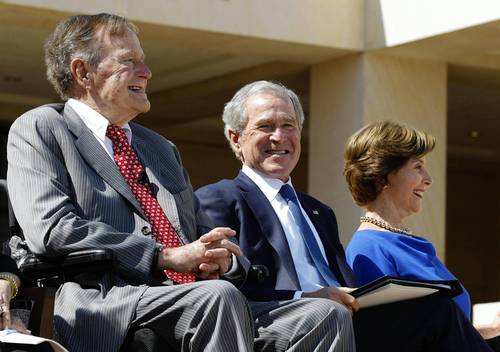 Former U.S. President George H. W. Bush, left, joins his son, former President George W. Bush, and former first lady Laura Bush during the dedication ceremony for the George W. Bush Presidential Center in Dallas.