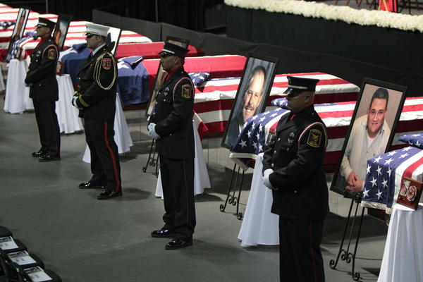 Honor guards stand at caskets at a memorial service for those killed in the West, Texas, fertilizer plant explosion. Most of those killed were volunteer first-responders.