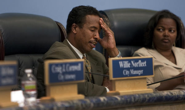 Compton Mayor Eric Perrodin tries to keep his composure as the City Council grapples with the budget four hours into a 2011 meeting. Perrodin was ousted in the city's municipal election after 12 years in office.