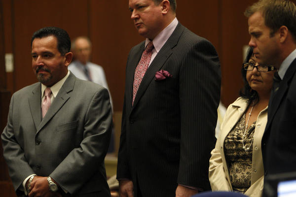 Irwindale City Councilman Mark Breceda, left, and former Irwindale City Councilwoman Rosemary Ramirez, second from right, appear in court in 2010.