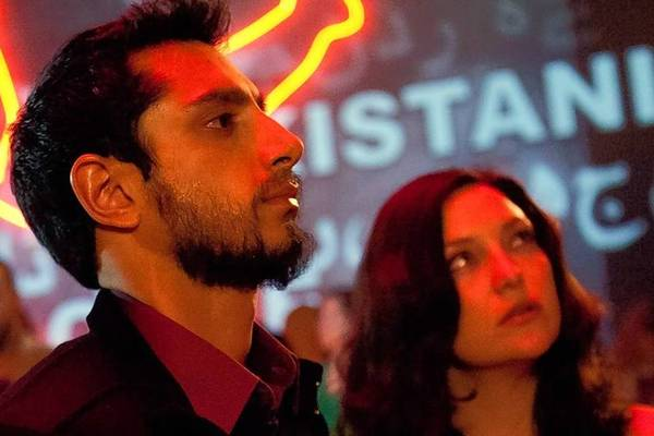 "Riz Ahmed, center, and Kate Hudson, right, in ""The Reluctant Fundamentalist."""
