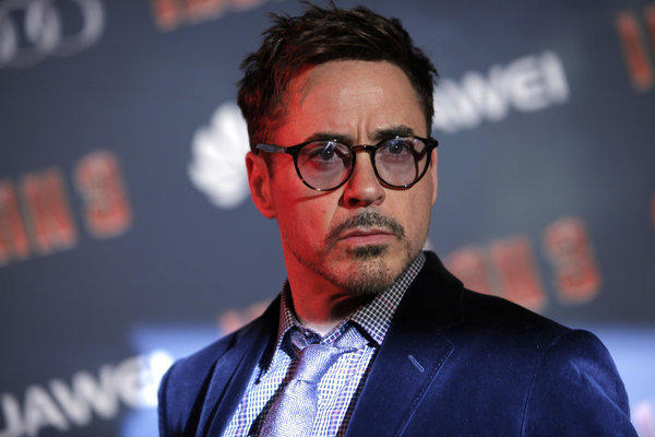 "Actor Robert Downey Jr. poses for photographers during the ""Iron Man 3"" premiere in Paris on April 14."