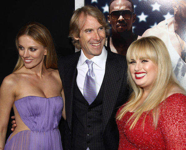 "Actress Bar Paly, left, director/producer Michael Bay and actress Rebel Wilson arrive at the L.A. premiere of ""Pain & Gain"" at the TCL Chinese Theatre on Monday."