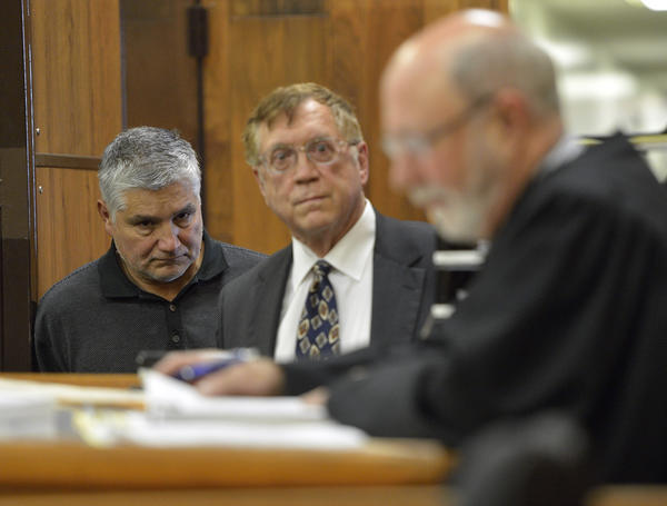 Robert Pimentel, left, a former fourth-grade teacher at George De La Torre Jr. Elementary School, is arraigned in Superior Court Judge James Otto's courtroom in Long Beach on Jan. 24, 2013. His attorney, Richard Knickerbocker, is at center.
