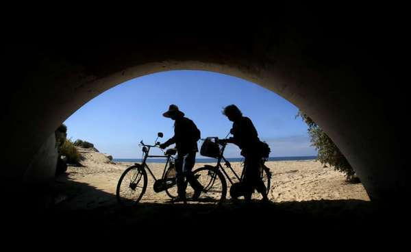 Bikers at Crystal Cove State Park, where the daily parking fee is $15.