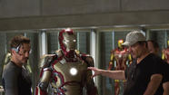 "Robert Downey Jr., left, and director Shane Black on the set of ""Iron Man 3."" (Zade Rosenthal / Marvel Entertainment)"