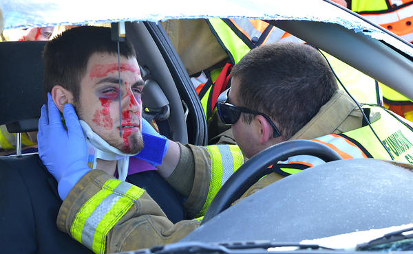 Matthew Eaton is treated at a mock accident scene that was part of the Prom Promise program Thursday at South Hagerstown High School.