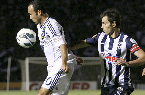 Galaxy midfielder Landon Donovan controls the ball under pressure from Monterrey's Jose Maria Basanta during a CONCACAF Champions League semifinal game earlier this month.