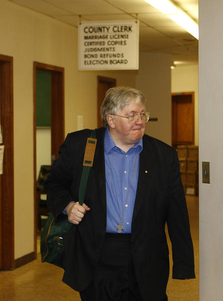 "Owen ""Butch"" Morgan walk to court for his trial on Tuesday morning in South Bend."