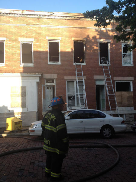 Firefighters battling a blaze in West Baltimore found the body of a man in a home in the 600 block of Claymont Avenue.