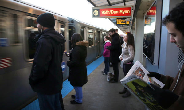 Commuters wait to board the Red line train at the congested Belmont St. station in Chicago, Friday, Dec. 14, 2012. (Antonio Perez/Chicago Tribune) B582581543Z.1 ....OUTSIDE TRIBUNE CO.- NO MAGS, NO SALES, NO INTERNET, NO TV, CHICAGO OUT, NO DIGITAL MANIPULATION... CTA