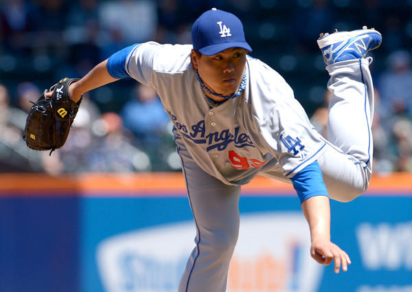 Dodgers starting pitcher Hyun-Jin Ryu follows through on a pitch against the Mets on Thursday afternoon at Citi Field in New York.