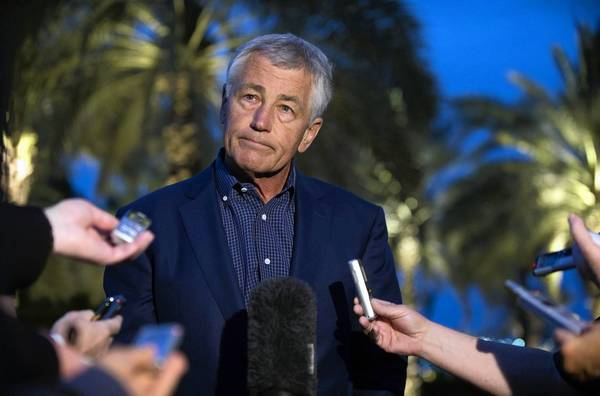 Defense Secretary Chuck Hagel speaks with reporters in Abu Dhabi, United Arab Emirates, after reading a statement on the U.S. allegations of chemical weapons use in Syria.