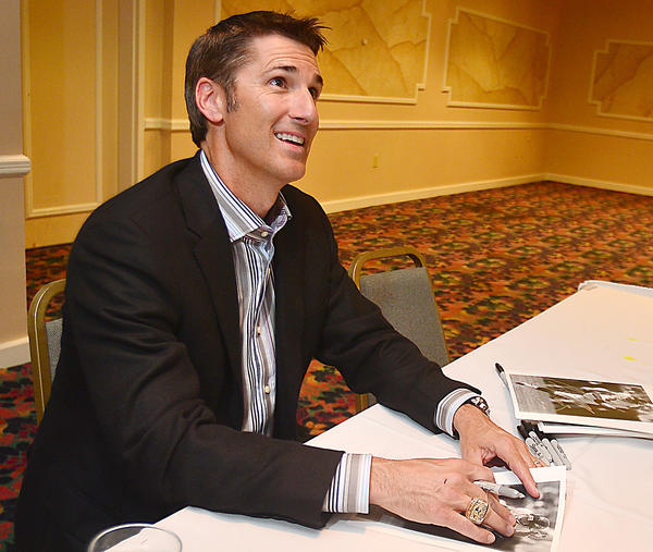 Former Baltimore Ravens kicker Matt Stover signs autographs Thursday at the Boys and Girls Club of Washington County Steak and Burger Dinner fundraiser at Hager Hall Conference and Event Center in Hagerstown.
