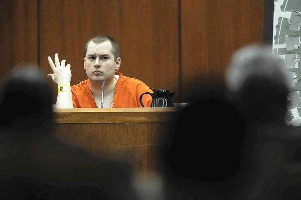 In DuPage County court, Jacob Nodarse testifies Thursday about how he killed three people, saying it was at the direction of the defendant, Johnny Borizov.