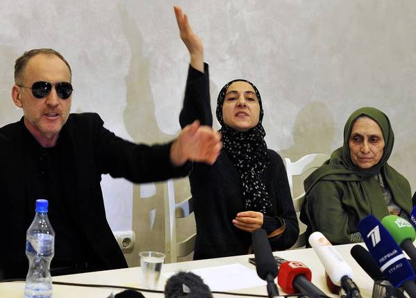 The parents of the Boston bombing suspects, Anzor Tsarnaev, left, and Zubeidat Tsarnaeva, appear at a news conference in Makhachkala, the capital of the Russian republic of Dagestan. With them is an aunt of the brothers, Patimat Suleymanova.